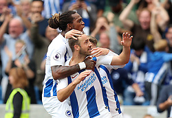 Brighton & Hove Albion's Glenn Murray (centre) celebrates scoring his side's first goal of the game with team mates during the Premier League match at the AMEX Stadium, Brighton.