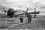 29/03/1963<br /> 03/29/1963<br /> 29 March 1963<br /> B.E.A. Aircrash at Dublin Airport. The crashed BEA Vanguard G-APEJ that carried 43 passengers and seven crew from London to Dublin. The Airport Terminal can be seen 1/2 mile in background. There were no fatalities in the accident. Note Emergency worker/ Fireman with hose on standby. Photos, Photo, Snap, Streets, Street,