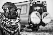 A portrait in black and white of aTurkana women wearing traditional stacked beaded necklaces, Lake Turkana, Loiyangalani,Kenya, Africa