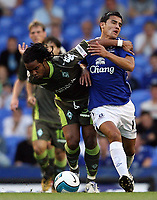 Photo: Paul Thomas.<br />Everton v Werder Bremen. Pre Season Friendly. 31/07/2007.<br /><br />Carlos Alberto of Bremen battles with Tim Cahill (R).