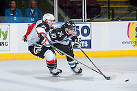 KELOWNA, CANADA - OCTOBER 23: Jared Bethune #21 of Prince George Cougars back checks Nick Merkley #10 of Kelowna Rockets during the first period on October 23, 2015 at Prospera Place in Kelowna, British Columbia, Canada.  (Photo by Marissa Baecker/Shoot the Breeze)  *** Local Caption *** Jared Bethune; Nick Merkley;