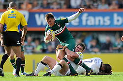 Leicester Tigers fly half Toby Flood is tackled by Newcastle Falcons hooker Rob Vickers - Photo mandatory by-line: Patrick Khachfe/JMP - Tel: Mobile: 07966 386802 - 21/09/2013 - SPORT - RUGBY UNION - Welford Road Stadium - Leicester Tigers v Newcastle Falcons - Aviva Premiership.