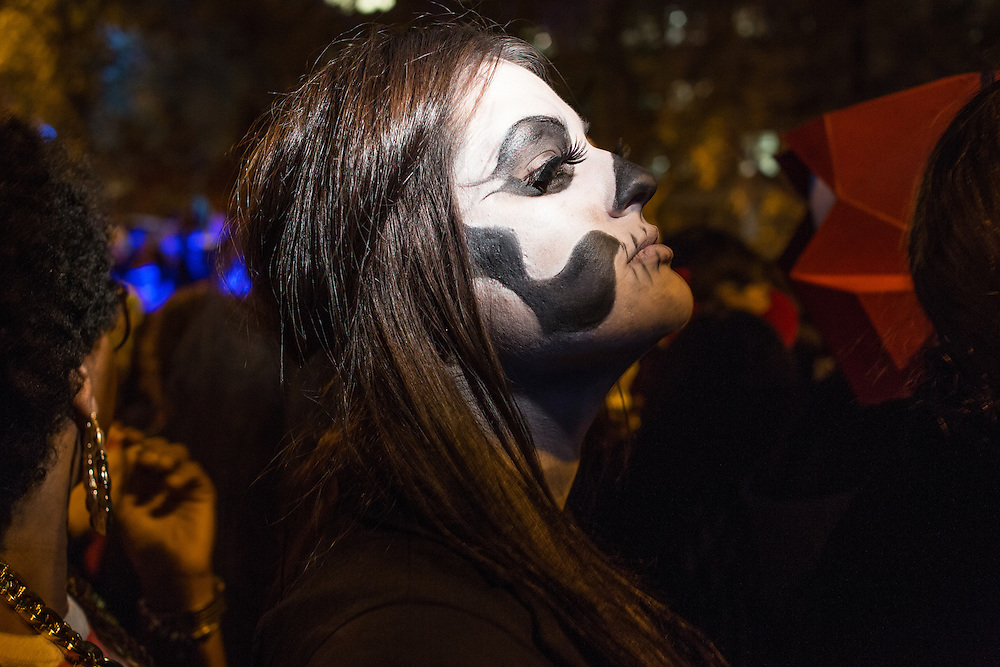 New York, NY, October 31, 2013.  A woman in face paint to resemble a Mexican catrina in the Green wich Village Halloween Parade.