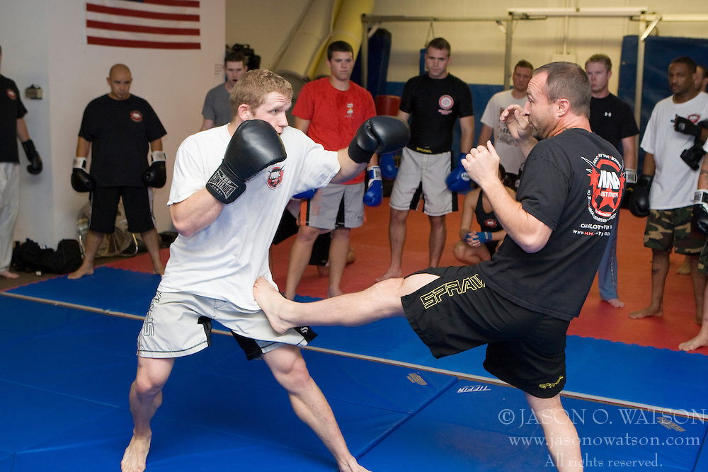 David Morris (right) demonstrates a kick to his class.  Mixed Martial Arts (MMA) students participated in a training class at American Freestyle Academy in Ruckersville, VA on September 16, 2008.  (Special to the Daily Progress / Jason O. Watson)