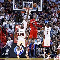 08 March 2011: Portland Trail Blazers power forward LaMarcus Aldridge (12) dunks the ball over Miami Heat shooting guard Dwyane Wade (3) during the Portland Trail Blazers 105-96 victory over the Miami Heat at the AmericanAirlines Arena, Miami, Florida, USA.