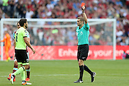 Referee Craig Pawson gives Harry Arter of AFC Bournemouth a second yellow and red card after pulling Cheikhou Kouyate of West Ham United down to the pitch . Premier league match, West Ham Utd v AFC Bournemouth at the London Stadium, Queen Elizabeth Olympic Park in London on Sunday 21st August 2016.<br /> pic by John Patrick Fletcher, Andrew Orchard sports photography.