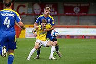 AFC Wimbledon defender Dan Csoka (3) battles with Brighton and Hove Albion striker Ben Wilson (58) during the EFL Trophy Southern Group G match between AFC Wimbledon and Brighton and Hove Albion U21 at The People's Pension Stadium, Crawley, England on 22 September 2020.