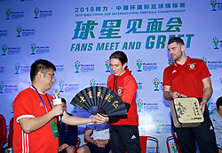 NANNING, CHINA - Saturday, March 24, 2018: Wales' Harry Wilson and Sam Vokes are presented with a traditional Chinese fan and a China tea set by supporters during a meet & greet event at the Nanning Wanda Mall during the 2018 Gree China Cup International Football Championship. (Pic by David Rawcliffe/Propaganda)