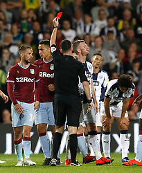 West Bromwich Albion's Chris Brunt is shown a red card for a second bookable offence by referee Chris Kavanagh