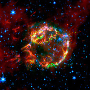 The scattered remains of an exploded star named Cassiopeia A. Much of the star's original layering had been preserved. NASA's Spitzer Space Telescope.
