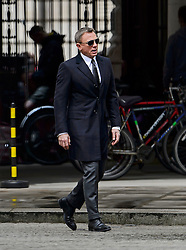 """© Licensed to London News Pictures. 30/05/2015. London, UK. . Filming for the new James Bond film """"Spector"""" with Daniel Craig (pictured) and Naomie Harris (not pictured) at the courtyard of the UK Government Treasury building in Westminster, London . Photo credit: Ben Cawthra/LNP"""