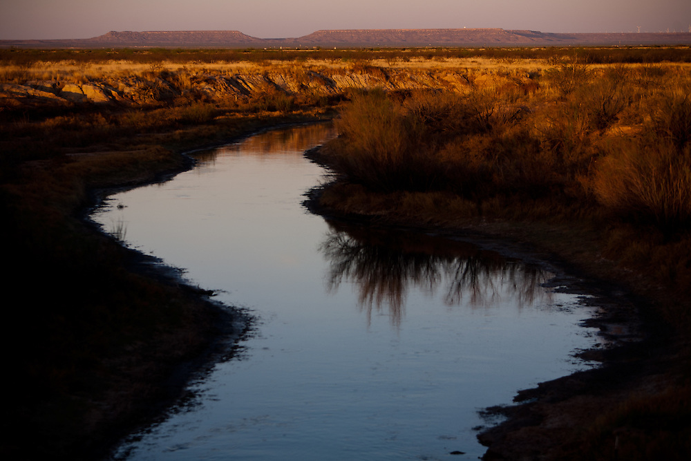 """Goodnight and Loving lost 100 head of cattle to quicksand and drowning at Horsehead Crossing on the Pecos River. Goodnight described the river that day as """"the graveyard of the cowman's hopes."""" Castle Gap appears in the distance."""