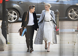 © Licensed to London News Pictures. 21/07/2020. London, UK. American actor AMBER HEARD (R) arrives with her girlfriend Bianca Butti at the High Court in London where Johnny Depp is in a legal dispute with UK tabloid newspaper The Sun over allegations he assaulted his former wife, Amber Heard. Photo credit: Peter Macdiarmid/LNP