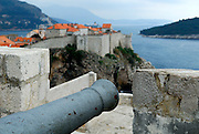 Cannon on Fortress Lovrinjenac (Fort of Saint Lawrence) overlooking Adriatic Sea, Dubrovnik old town and Island of Lokrum