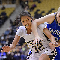 021914       Cable Hoover<br /> <br /> Chinle Wildcat Naomi Yazzie (32) and Safford Bulldog Holly Hancock (33) lose the ball as they struggle for a rebound Wednesday at Chinle High School.
