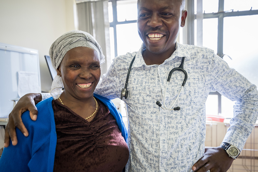 2 March 2017, Ma Mafefooane Valley, Lesotho: Patient Clementina (left) and Dr Mulamba (right) of Saint Joseph's Hospital. Saint Joseph's Hospital is a district hospital in the Ma Mafefooane Valley in Lesotho. The hospital was established in 1937 and is run as a Roman Catholic non-profit institution by the Christian Health Association of Lesotho. As a district hospital, it offers comprehensive healthcare including male, female, paediatric, Tuberculosis and maternity care. It is closely linked with the neighbouring Roma College of Nursing, which runs on similar premises as part of the same institution. Drug supplies are secured to the hospital by means of a Memorandum of Understanding with the government.