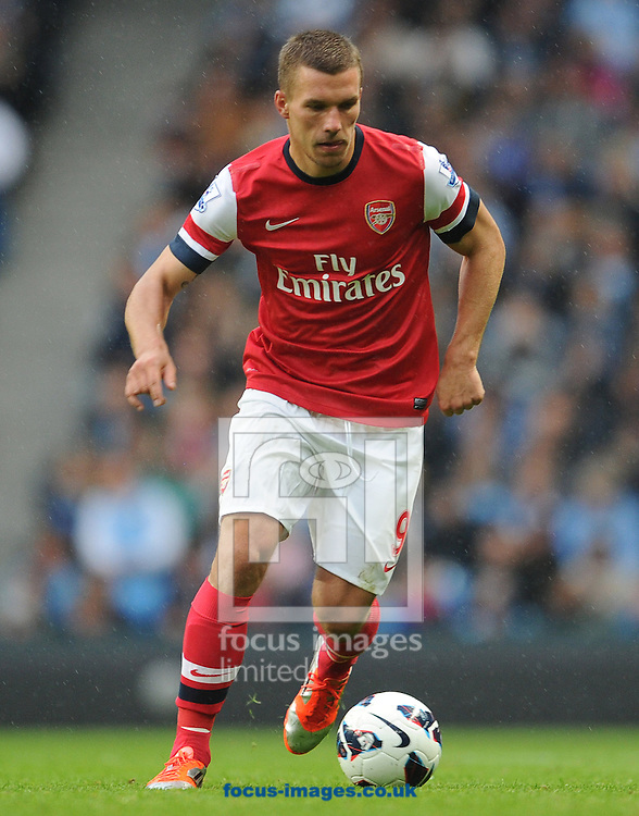 Picture by Andrew Timms/Focus Images Ltd +44 7917 236526.23/09/2012.Lukas Podolski of Arsenal during the Barclays Premier League match against Manchester City at the Etihad Stadium, Manchester.