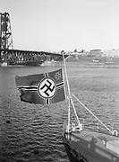 "9969-2271. Swastika flag signifying Hitler's dictatorship of Germany. January 28, 1936. German training ship ""Emden"" in Portland, Oregon."