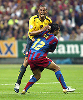 Photo: Chris Ratcliffe.<br /> Arsenal v Barcelona. UEFA Champions League Final. 17/05/2006.<br /> Gilberto tussles with Giovanni Van Bronckhurst.