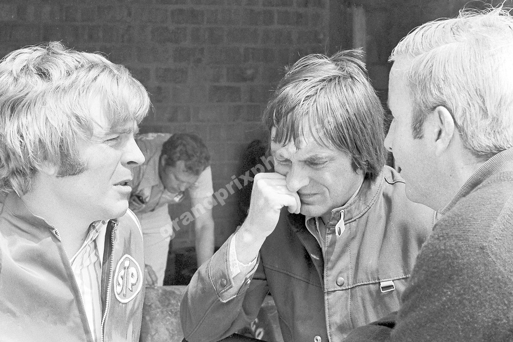 Team princpals Max Mosley (March-Ford), Bernie Ecclestone (Brabham-Ford) and Teddy Mayer (McLaren-Ford) in the pits before the 1972 Belgian Grand Prix in Nivelles.  Photo: Grand Prix Photo