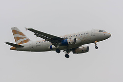 """London Heathrow Airport, November 16th 2014. A British Airways Airbus A319 in gold """"Dove"""" livery, designed by Brighton-based designer Pascal Anson, prepares to land on runway 09L at London's Heathrow Airport."""
