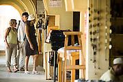 Customers browse through stores at the Village Artisanal de Ouagadougou, a cooperative that employs dozens of artisans who work in different mediums, in Ouagadougou, Burkina Faso, on Monday November 3, 2008.