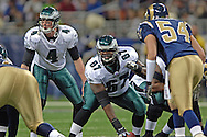 St. Louis Rams linebacker Brandon Chillar (54) stares in a Philadelphia quarterback Mike McMahon (4) as he calls a play before taking the snap from center Jamaal Jackson (67), at the Edward Jones Dome in St. Louis, Missouri, December 18, 2005.  The Eagles beat the Rams 17-16.