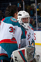 KELOWNA, CANADA - JANUARY 3: Roman Basran #30 and James Porter #1 of the Kelowna Rockets exit the ice after the win against the Tri-City Americans on January 3, 2017 at Prospera Place in Kelowna, British Columbia, Canada.  (Photo by Marissa Baecker/Shoot the Breeze)  *** Local Caption ***