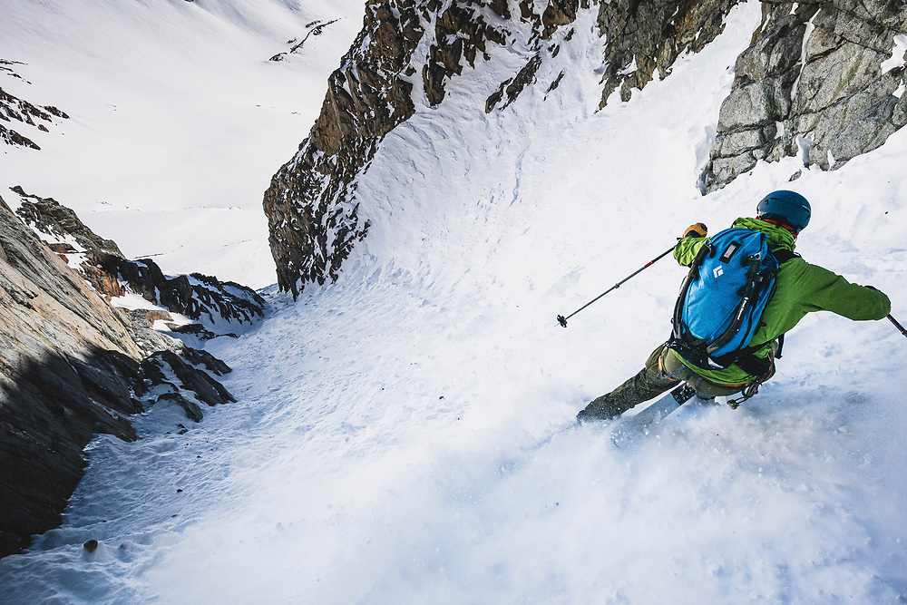 After retreating from the rocky middle section of the Split Couloir, Noah Howell gets hoppy for the exit, Sierras.