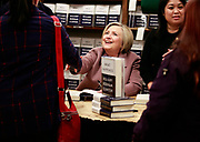 """Hillary Rodham Clinton talks with crowds and signs her new book, """"What Happened"""" at Elliott Bay Book Company in Seattle Tuesday, Dec. 12, 2017.<br /> (Erika Schultz / The Seattle Times)"""