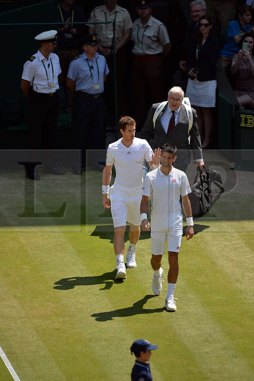 © London News Pictures. 07/07/2013 . London, UK. Andy Murray and Novak Djokovic enter Centre Court ahead of the men's singles final  at the Wimbledon Lawn Tennis Championships final. Andy Murray won the match  becoming the first British male to win the tournament in 77.  Photo credit: Mike King/LNP