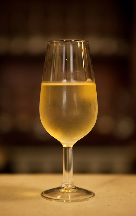 A glass of sherry wine at El Cañón bar in Cadiz, Andalucía, Spain.