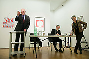 Auctioneer Chris Knapton going through the bids. In the back ground is a piece by Bob and Roberta Smith. Art auction held at Gimpel Fils in support of Ken Livingstone's bid for London Mayor in May 2012.