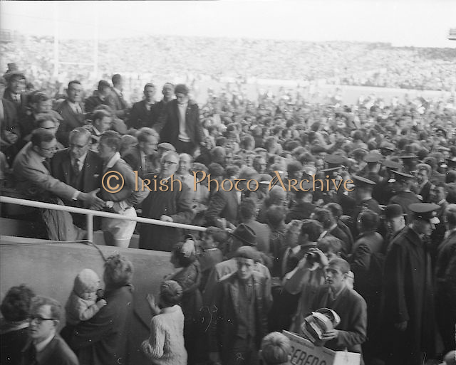 Large crowds on the pitch and  stands after the All Ireland Senior Gaelic Football Final Kerry v Offaly in Croke Park on 28th September 1969. Kerry 0-10 Offaly 0-7.