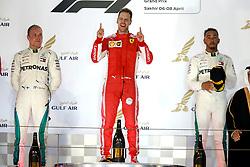 April 8, 2018 - Sakhir, Bahrain - Motorsports: FIA Formula One World Championship 2018, Grand Prix of Bahrain, , #5 Sebastian Vettel (GER, Scuderia Ferrari)#44 Lewis Hamilton (GBR, Mercedes AMG Petronas F1 Team), #77 Valtteri Bottas (FIN, Mercedes AMG Petronas) (Credit Image: © Hoch Zwei via ZUMA Wire)