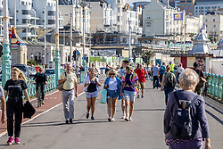 Licensed to London News Pictures. 23/09/2021. Brighton, UK. Members of the public enjoy the sunny weather in Brighton, Sussex as weather forecasters predict warm autumnal weather to continue for the weekend with highs of 24c. Photo credit: Alex Lentati/LNP