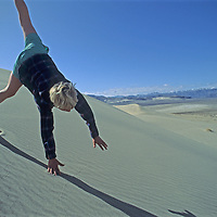 A youngster cartwheels down sand dunes in Eureka Valley, part of California's Death Valley National Park.