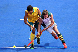 Joel Carroll of Australia and Lloyd Norris-Jones of South Africa battle for the ball during the men's Hockey match between Australia and South Africa held at the Riverbank Stadium in the Olympic Park in London as part of the London 2012 Olympics on the 30th July 2012.Photo by Ron Gaunt/SPORTZPICS