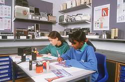 Secondary school girls working in art and design class,