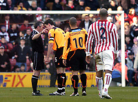 Photo. Glyn Thomas. <br /> Stoke City v Sheffield United. <br /> Coca Cola Championship. 12/03/2005.<br /> Sheffield's captain Chris Morgan (second from L) confronts referee Mathieson (L) as a decision goes against his team.