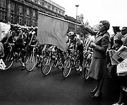 Actress Siobhan McKenna about to drop the flag to start the Rás Tailteann. The cycle race, which covers 900 miles around Ireland, would finish in Limerick on 12 June. A field of seventy-seven riders were listed to take part.<br /> 07/06/1975