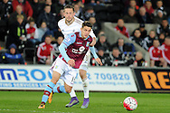 Aston Villa's Ashley Westwood  is challenged by Swansea's Gylfi Sigurdsson. Barclays Premier league match, Swansea city v Aston Villa at the Liberty Stadium in Swansea, South Wales on Saturday 19th March 2016.<br /> pic by  Carl Robertson, Andrew Orchard sports photography.