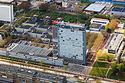 Nederland, Zuid-Holland, Delft, 09-05-2013; overzicht Campus TU Delft. Gebouw met logo is Elektrotechniek, Wiskunde en Informatica (EWI)..Overview of the Campus of the Delft University of Technology. The high-rise red-striped building with logo is the faculty of Electrical Engineering, Mathematics and Computer Sciences (EEMCS)..luchtfoto (toeslag op standard tarieven).aerial photo (additional fee required).copyright foto/photo Siebe Swart