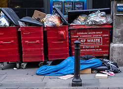 FILE IMAGE © Licensed to London News Pictures. 22/10/2019. London, UK. A homeless man sleeps next to rubbish bins in Villiers Street, just off the Strand known for its cafès and wine bars. Pictures highlight the reality of homelessness in Westminster taken during the build up of Brexit and the General election just a few hundreds yards from Parliament and Downing Street. Photo credit: Alex Lentati/LNP