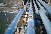 Alaska. North Slope. Alyeska Pipeline. Trans Alaska Pipeline. Construction on pipeline and pipeline industry buildings on the North Slope.