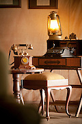 Antiques around the lounge at the luxury Cottars 1920s Safari Camp in the Cottars Conservancy, Kenya