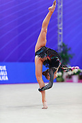 Tashkenbaeva Sabina during final at clubs in Pesaro World Cup at Adriatic Arena on April 15, 2018. Sabina is an Uzbek  rhythmic gymnast  was born in Tashkent, 2000. She began competing in gymnastics at age six. His dream is to participate in the upcoming Tokyo Olympics in 2020.