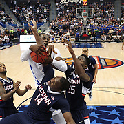 D'Andre Wright, Tulsa, rebounds while challenged by Rakim Lubin and Amida Brimah, (right), UConn, during the UConn Huskies Vs Tulsa Semi Final game at the American Athletic Conference Men's College Basketball Championships 2015 at the XL Center, Hartford, Connecticut, USA. 14th March 2015. Photo Tim Clayton