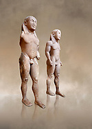 Archaic Ancient Greek marble statue of 2 Kouros Known as the Twins of Argos sculpted in Argos circa 580 BC, Delphi National Archaeological Museum.