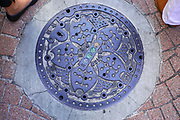 Ornamented manhole cover in Tokyo. Japan